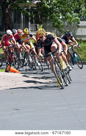 Cyclist Leads Pack Around Turn
