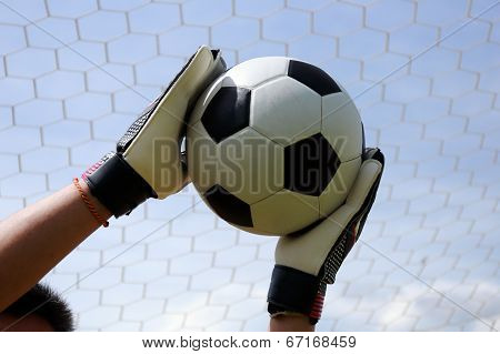 Goalkeeper's Hands Reaching Foot Ball