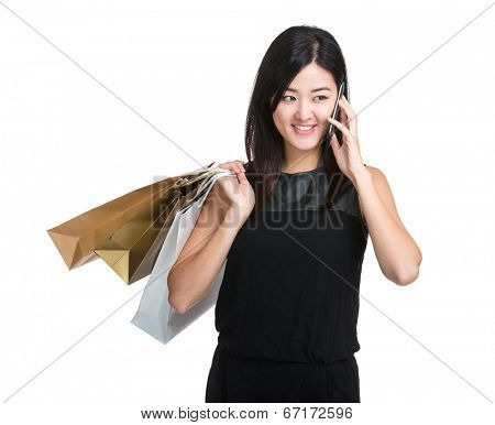 Shopping woman with paper bag and mobile phone