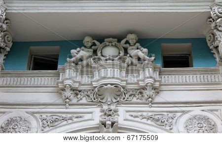 fretwork angels on the building