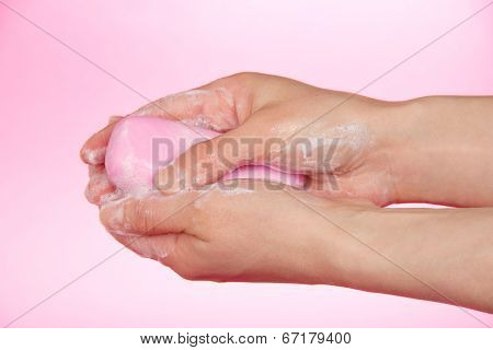 Piece of toilet soap in the female hands