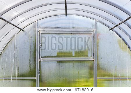 Fragment Of Modern Greenhouse Interior With Wet Walls