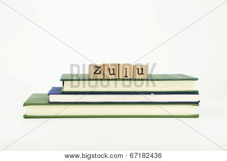 zulu language word on wood stamps and books