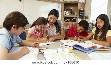 Teacher and schoolchildren in class
