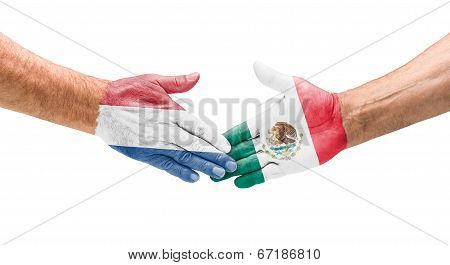 Handshake Netherlands and Mexico on a white background