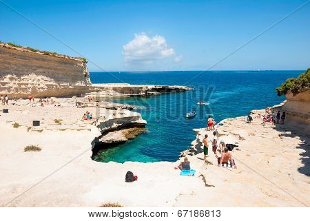 People At The Coast At Marsaskala, Malta