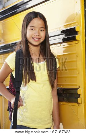 Pre teen girl with school bus