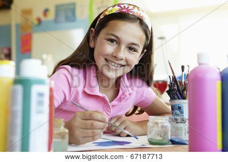 Pre teen girl in art class