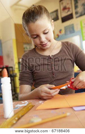 Pre teen girl in art and craft class