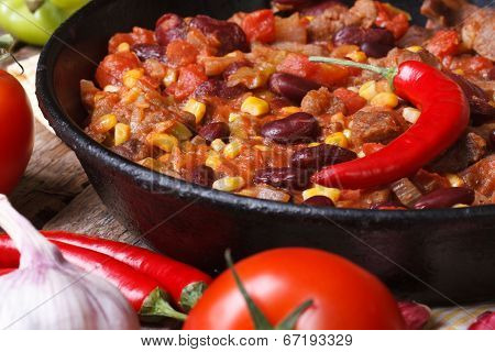 Mexican Chili Con Carne In A Pan On A Wooden Background