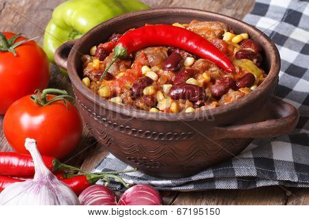 Hot Chili Con Carne In A Saucepan And Ingredients Horizontal