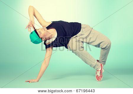 Modern girl dancer dancing in hip-hop style. Urban street style.