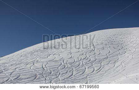 Curvy Ski Tracks In The Snow