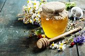 image of sweet food  - Honey and Herbal tea on wooden background  - JPG