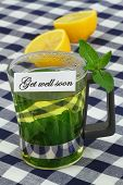 stock photo of get well soon  - Get well soon card with mint tea and fresh lemon