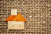 pic of tangram  - abstract picture of a house built from seven tangram wooden pieces - JPG