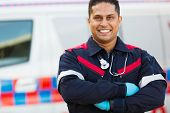foto of paramedic  - portrait of male paramedic with arms crossed - JPG