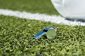 picture of offside  - Whistle and soccer ball on a soccer field - JPG
