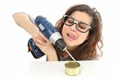 image of geek  - Funny geek girl trying to easy open a tin with a drill isolated on a white background - JPG