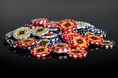 image of crap  - Poker chips on the table in the casino On black background - JPG