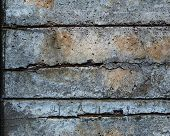 stock photo of dimples  - Old and disintegrating steel reinforced old concrete wall with rusted internal steel beams - JPG