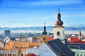 stock photo of sibiu  - Roman Catholic Church and old town view in Sibiu - JPG