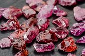 stock photo of uncut  - Set of uncut rough and raw Rhodolite garnets - JPG