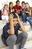 stock photo of pre-teen boy  - Boy being bullied in school - JPG