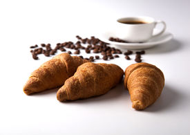 picture of peppy  - three croissant and a cup of coffee with coffee beans on grey - JPG