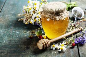 foto of sweet food  - Honey and Herbal tea on wooden background  - JPG