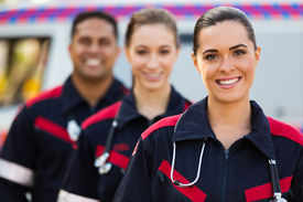 foto of ambulance  - confident young paramedic team in front of ambulance - JPG