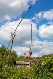 pic of shadoof  - Tihany Abbey with a shadoof at Lake Balaton Hungary - JPG