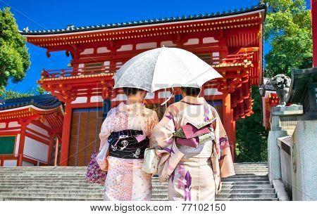 Japanese girls with Japanese traditional suit (Yukata) are walking in the Yasaka-jinja  shrine in Kyoto, Japan.