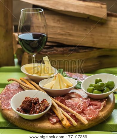 Different Italian Antipasti And Red Wine