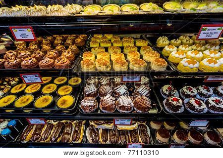 Fresh Sweet Baked Goods Being Sold in Display Windows