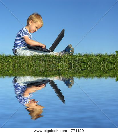 child with notebook sit blue sky and water