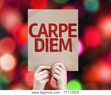 Carpe Diem written on colorful background with defocused lights