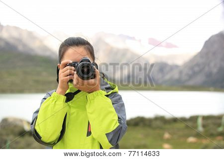 woman photographer taking photo at tibet,china