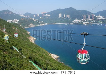 Tourists Travel In Cable Car In The Ocean Park, Hong Kong