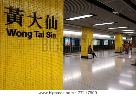 Travellers Walk To Wong Tai Sin Station To Take The Train
