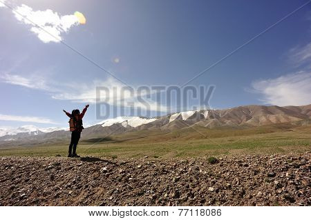 cheering woman  at mountain peak in tibet,china