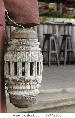 Wooden lantern in the roadside cafe in Thailand