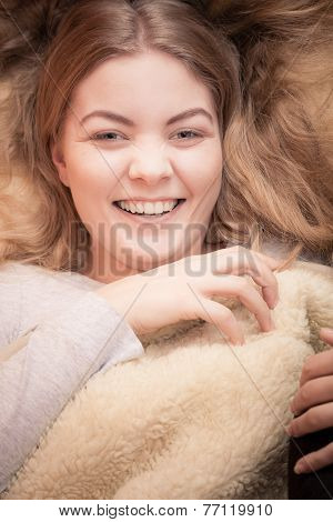Smiling Woman Waking Up On Bed