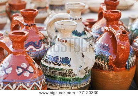 Romanian traditional pottery handcrafted mugs at a souvenir shop. Romanian traditional handcrafted