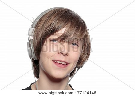 Smiling Teenage Boy With Headphones, Isolated On White