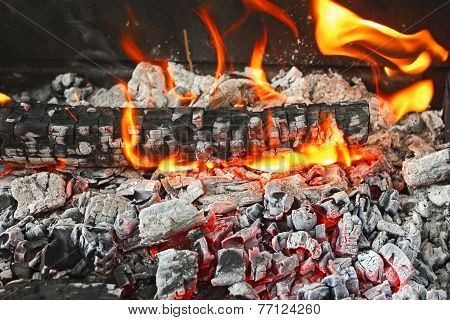 Burning Firewood With Ashes