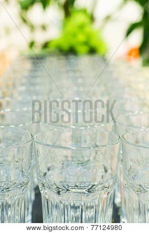 Close Up Row Of Glass Kitchen Dinnerware Equipment