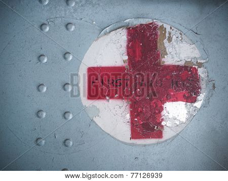 Red Cross Sign On Old Metal Plate