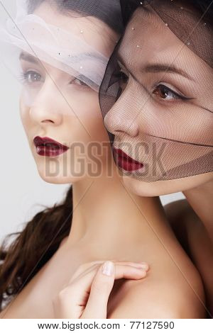 Fondness. Two Females In Veils Embracing
