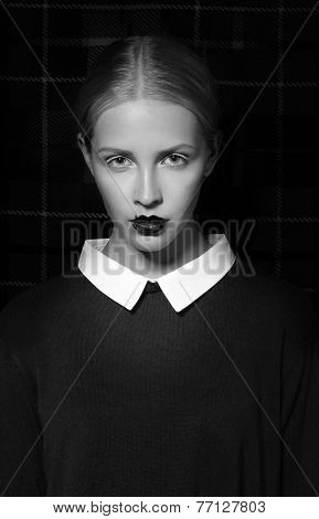 Studio Portrait Of Strict Woman With White Collar